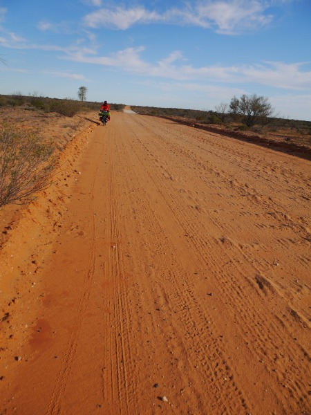 Typical corrugation on the track. Usually there's a narrow strip that is not too bad and give a good ride. Expect hard work if you have a 2-wheeled trailer or a recumbent trike, as you won't be able to use that narrow strip.