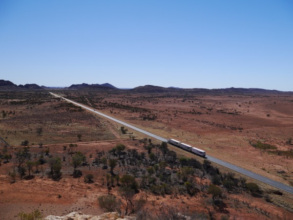 The highway is actually not too bad, even though shoulders are usually narrow. Make sure to get off the road when you hear a roadtrain coming, even though they should give you a wide clearance.